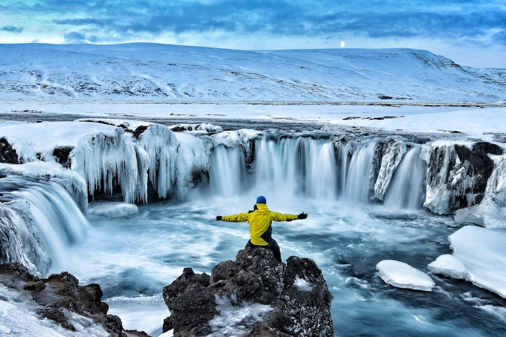 Adventure hike to Iceland waterfalls in the snow