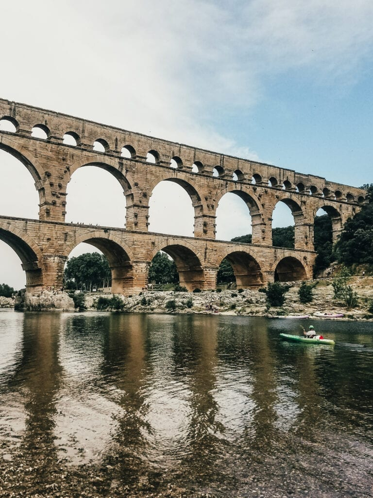 Kayaking under Pont du Gard Roman Aqueduct during Uniworld River Cruise excursion